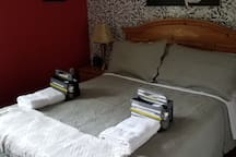 Bedroom 2 - Queen Bed. Iron and Ironing Board Available.