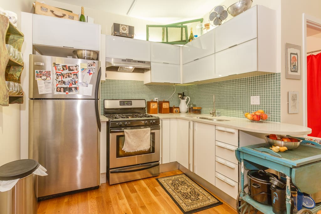 Large open kitchen with gas stove and microwave.