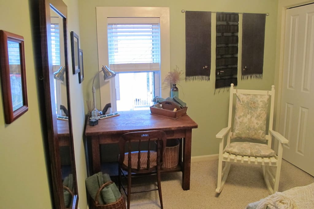 Desk, rocking chair, closet and full-length mirror