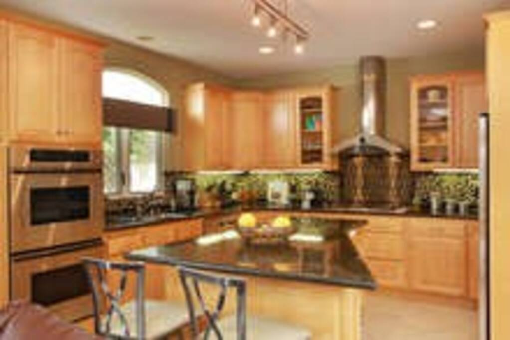 European-style Kitchen with Granite Countertops and Double Oven