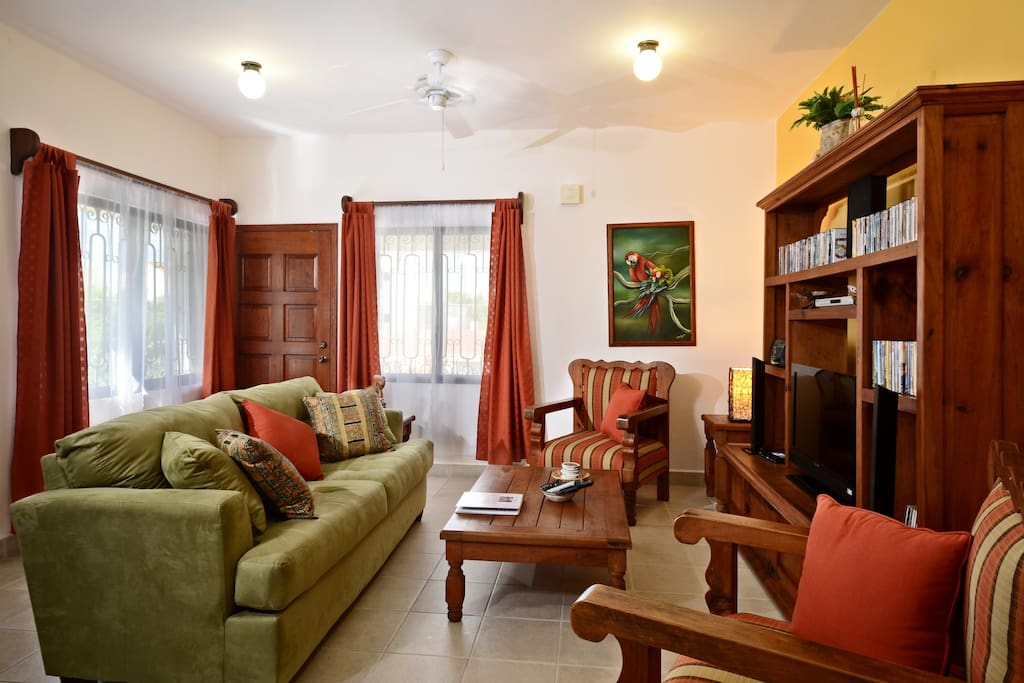 Living area with a comfortable sofa, 40 inch flat panel TV with cable, DVD player and movies.