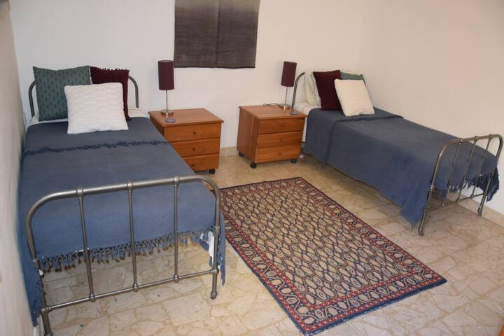 Spacious, well furnished and comfortable  single beds with memory foam mattresses, bed side tables and wardrobe. Room is bright and airy with natural light  through a window onto a large internal courtyard. Coool in summer and cosy in winter