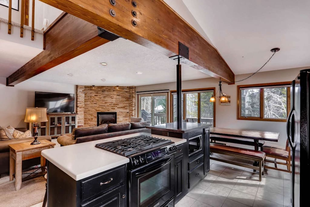 Open Concept Kitchen-Living Room for Socializing and Relaxing