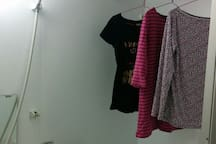 Clothes dryers are in the bathroom.