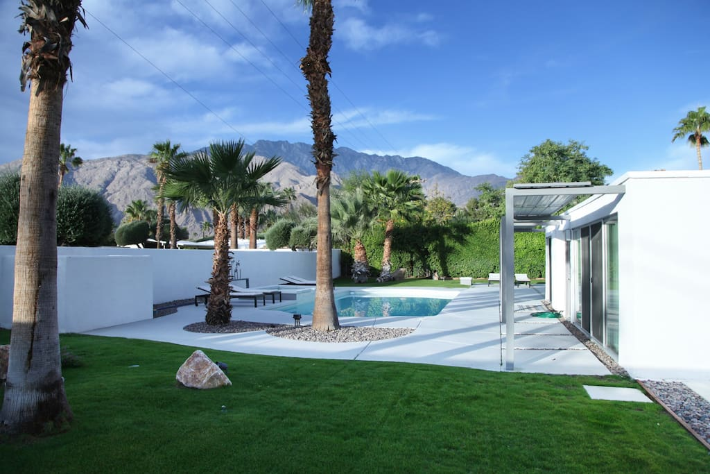 View from the yard of the pool, spa and mountains beyond