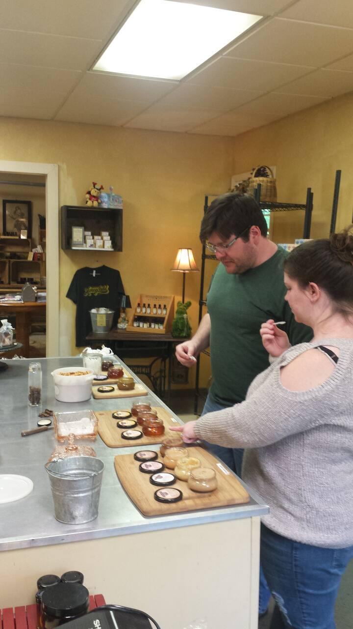 Guests sampling various honey products