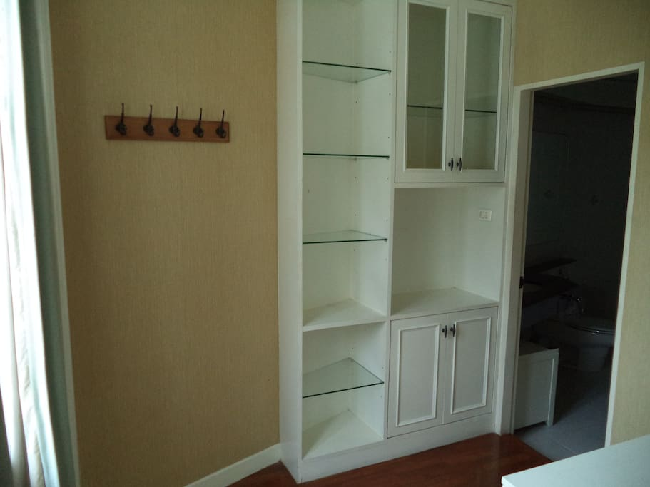 Area around the bathroom with dressing table & storage.