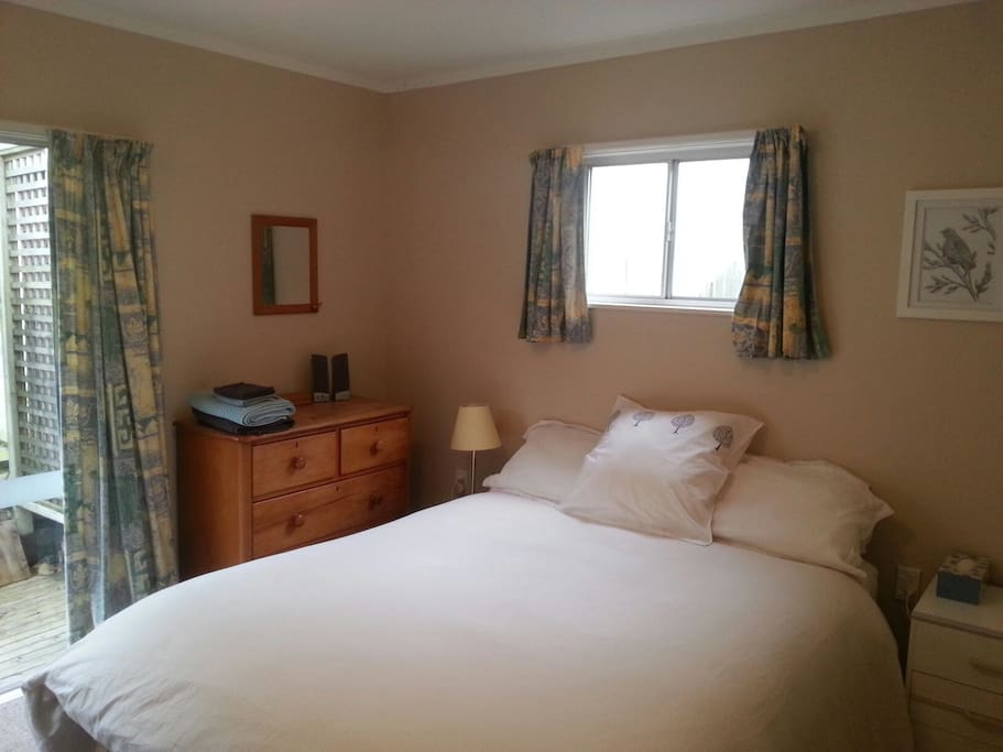Large double bedroom with queen sized bed.
