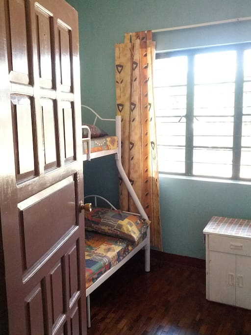 Room 1, located in the front area of the house, can sleep 6