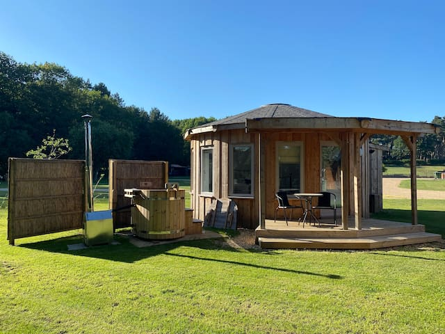 Timber framed roundhouse with hot tub, King's Oak