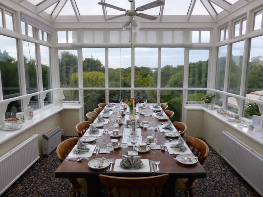 Conservatory dining room with views over the garden & river