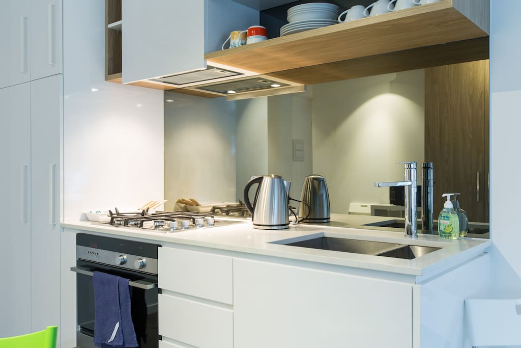 Modern kitchen with complete utensils and dishwasher!
