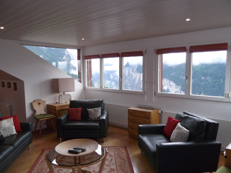 Lounge with 2 sets of triple folding windows overlooking the Lauterbrunnen Valley.