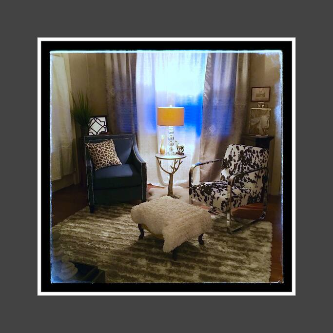 Two of the recently ordered contemporary, comfortable chairs with a cozy faux fur ottoman for enjoying a good book or a favorite TV show, Movie or Sports event!!