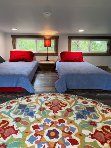 Shallow open loft sleeping area. Ceiling is less than 5ft. Beds are super comfy!