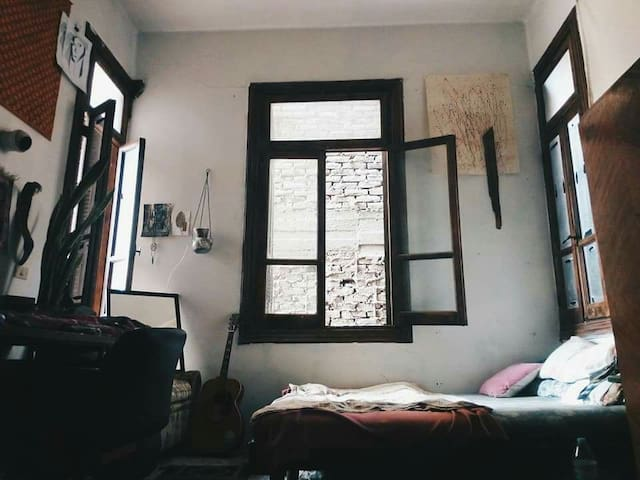 A lovely cozy room in a sunny beautiful flat.