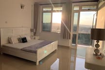 This is the lovely Master Bedroom. You can sit on your bed and take in the lovely views.