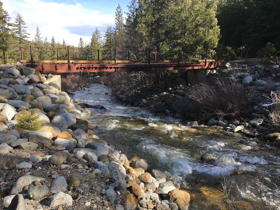 You will be greeted by a welcoming bridge and flowing creek as you pull into the property.