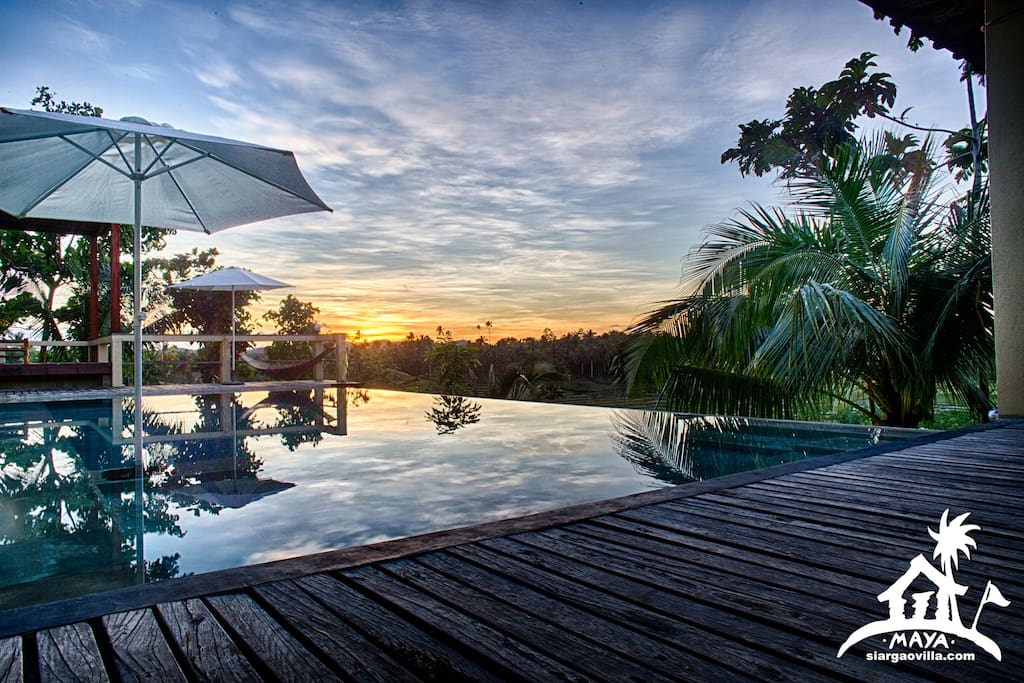 infinity swimming pool at sunset