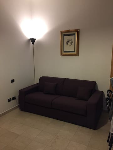 Couch bed folded in living room