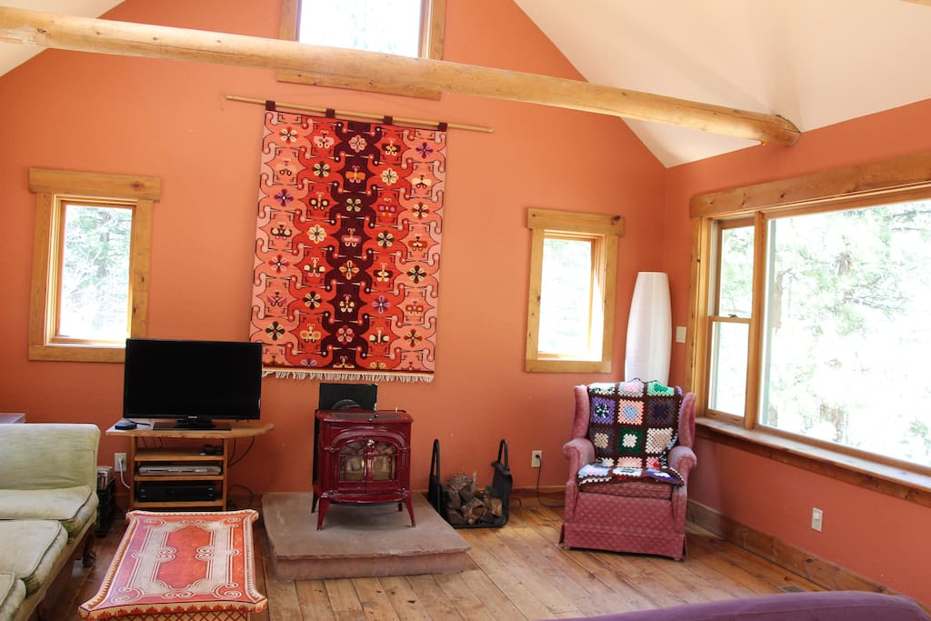 Upstairs living area - cozy woodstove to warm up cool summer nights.