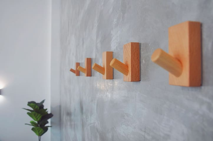 Our unique preserved cement wall with wooden Feels
