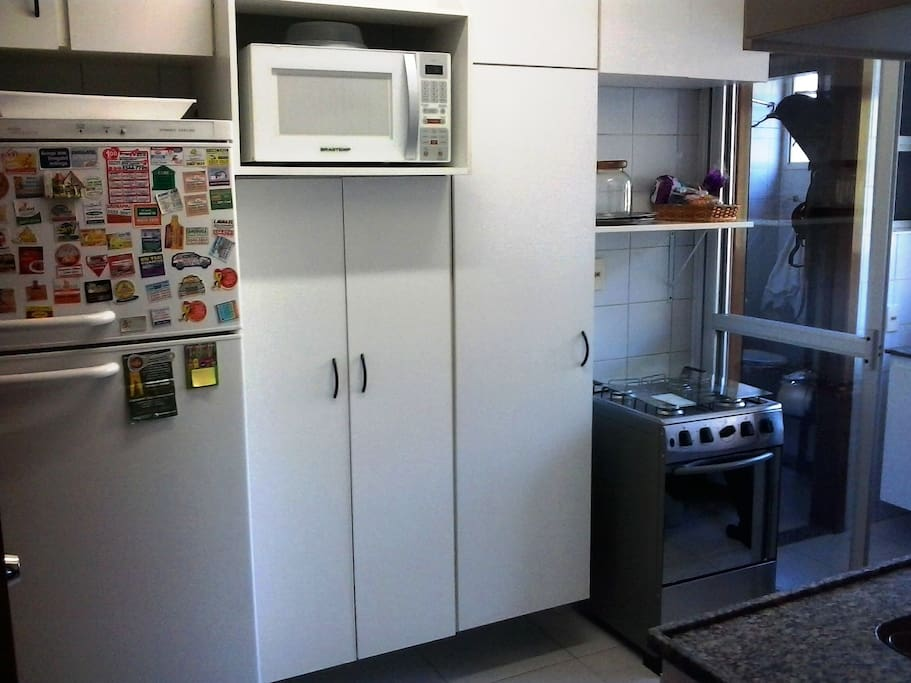 Kitchen with: Fridge, Microwave Oven, Oven and Kitchen gadgets