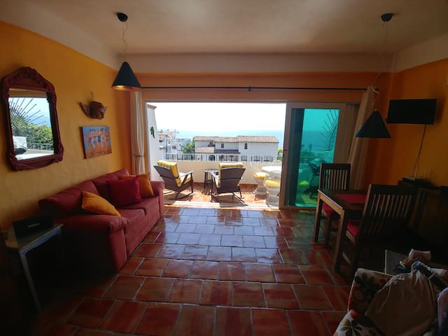 Very large studio furnished in traditional Mexican decor overlooking the Bay of Banderas and Zona Romantica. You can watch the whales in the Bay from the comfort of your balcony!