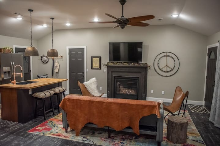 """Living Room with Gas fireplace and 58"""" 4K television w/ cable, streaming channels and wifi"""
