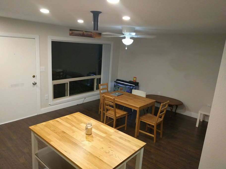 view from kitchen to living/dining. notice the Amazon echo hanging from the ceiling. to the right of the gecko above the window, there is a weather station monitoring temperature, humidity and CO2 levels.