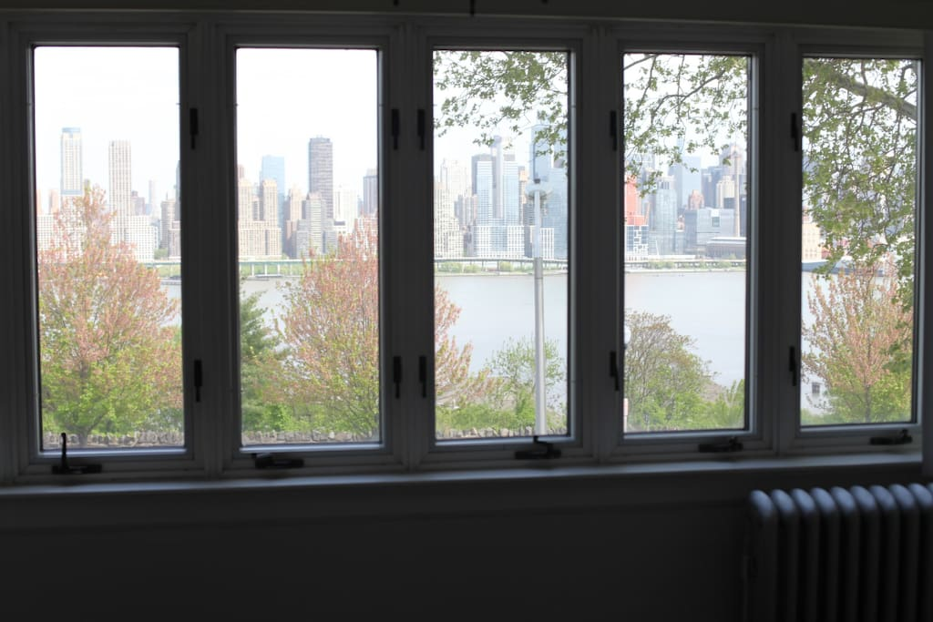 This is the view from the living room of the apartment. A beautiful view of the Manhattan Skyline.