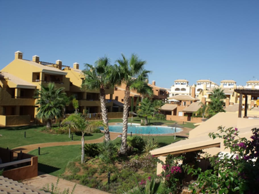 The view of the pool from the sun terrace