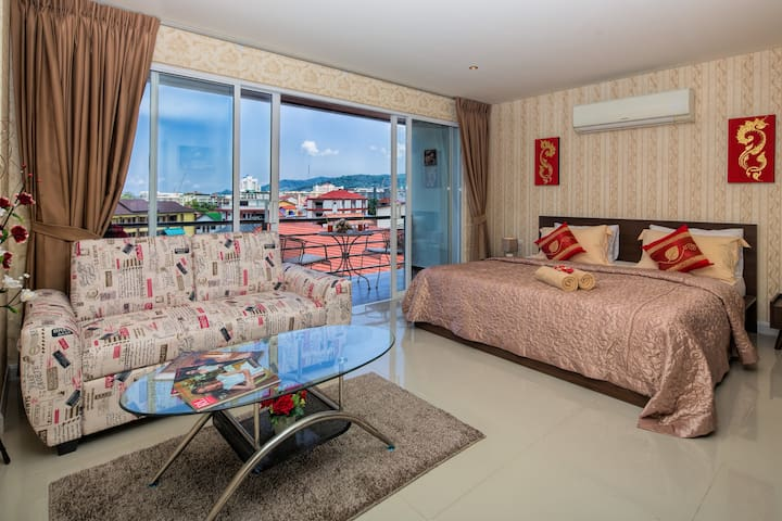 Comfortable bed with panoramic city view