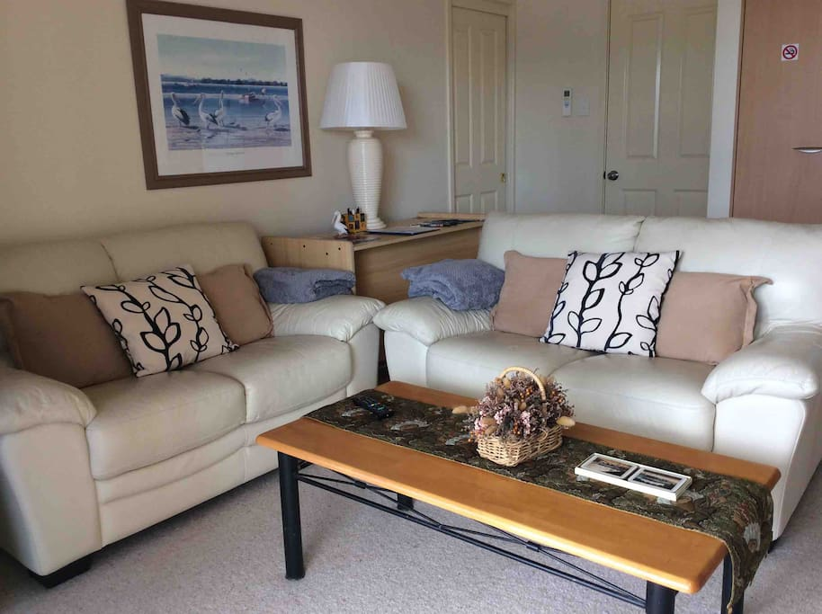 Lounge area with very comfortable leather lounge and fantastic views across Lake Macquarie.