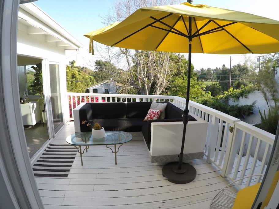 View of deck from master bedroom. Stairs from deck take you down to large private garden