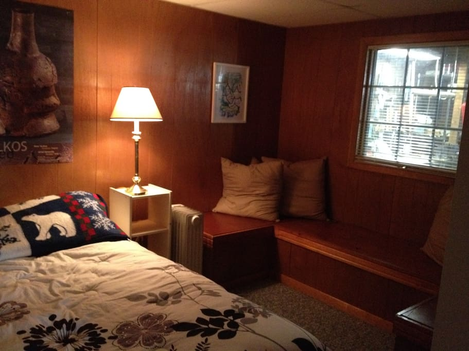 Bedroom with queen bed and built-in cedar chests