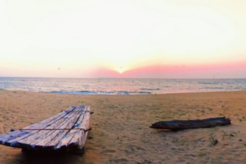 Private beach with sunset over the Indian ocean