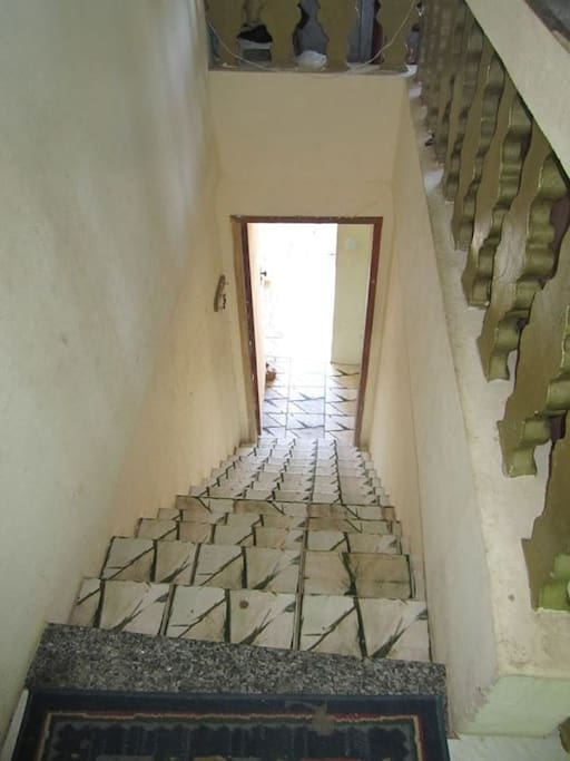 Stair that give access to both apartments.