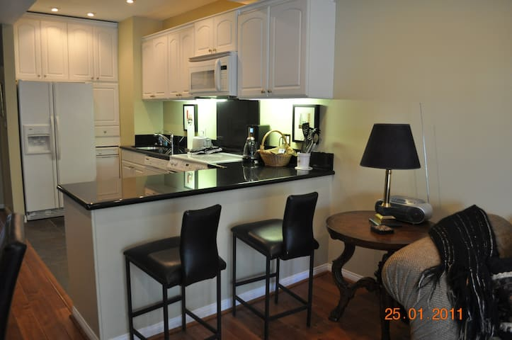 Breakfast bar and full size table make dining a breeze.