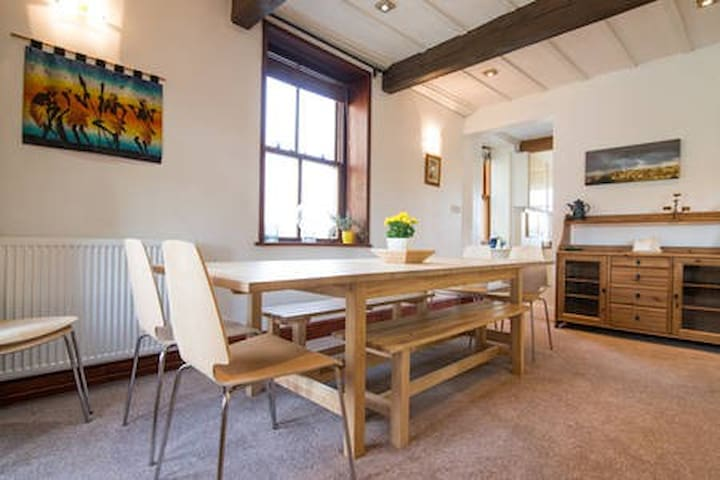 Dining table with 6 dining chairs and 2 bench seats to seat 12 guests in total, plus use of a high chair if needed