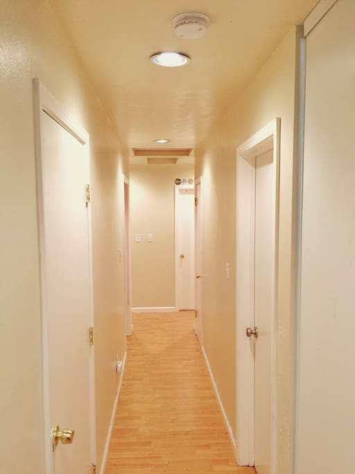 Hallway to all bedrooms.  The washer and dryer is also located behind the left wall.