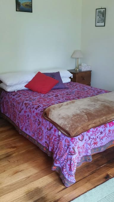 Comfortable double bed in main room.