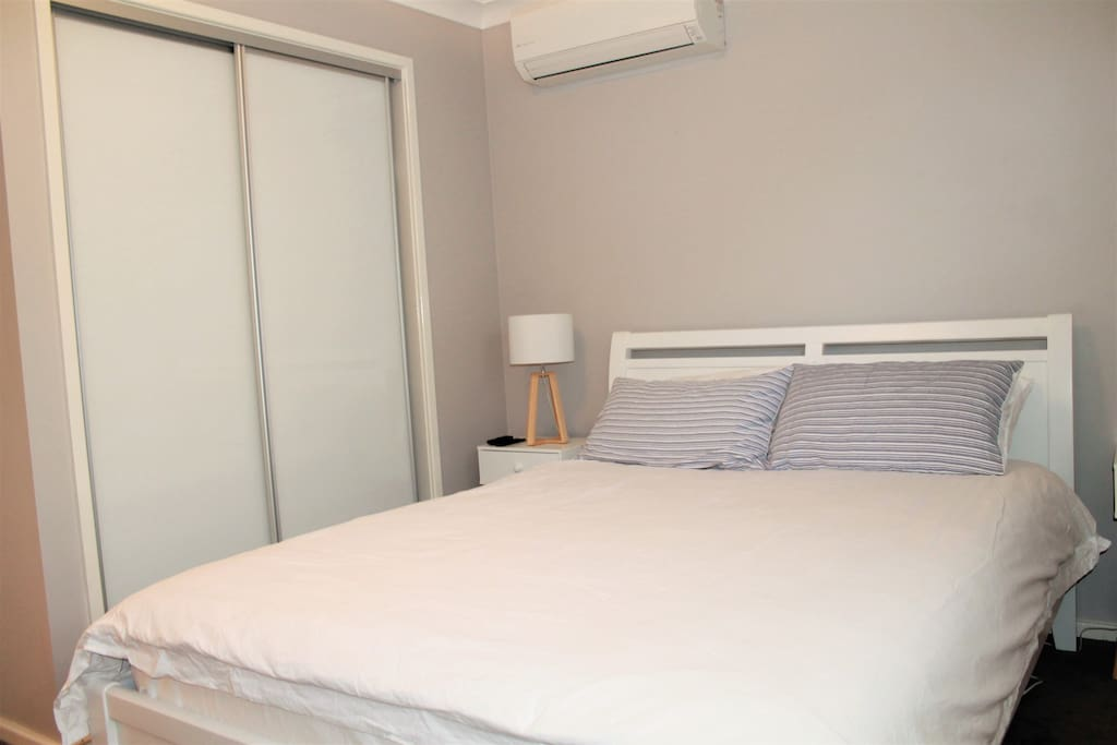 Air conditioner and wardrobe available in the bedroom for guest use.