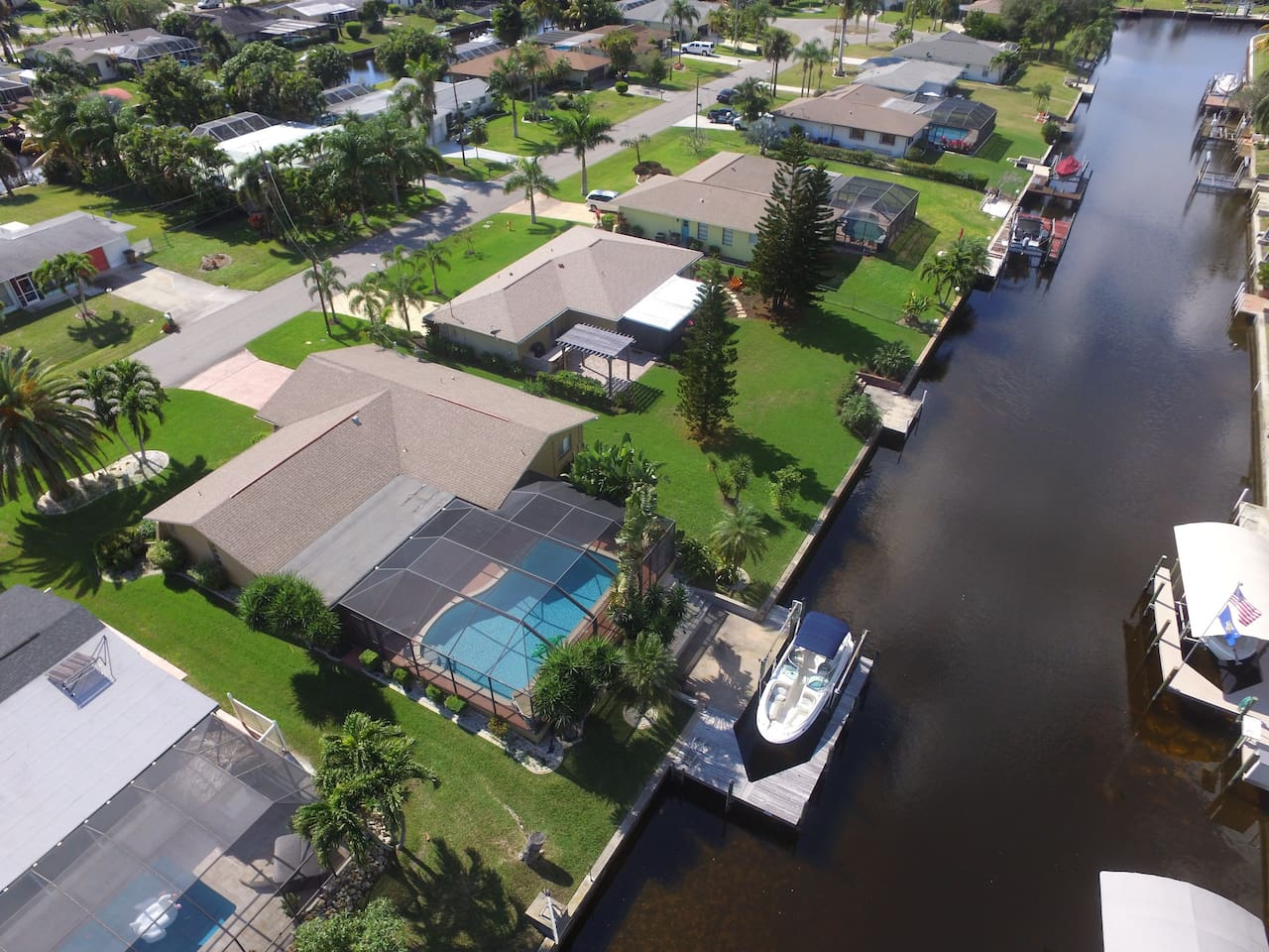 Stunning waterfront pool home in the much desired SE Yacht Club area of Cape Coral.