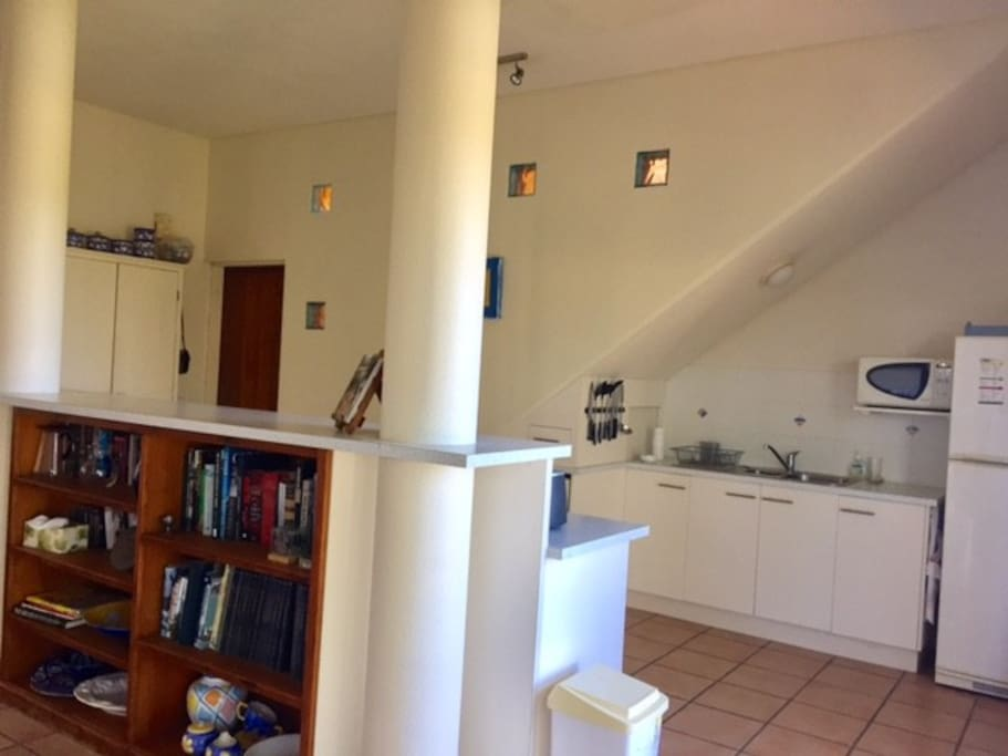 Kitchen leading onto balcony with view