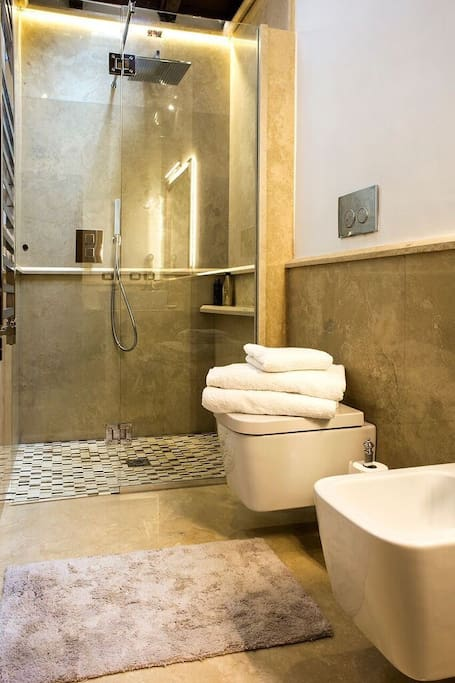 All new Italian finished bathrooms, with walk in shower, fluffy towels, bathrobes and slippers.