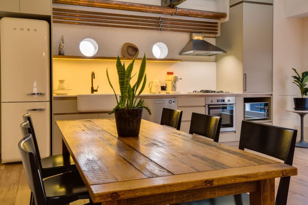 Dining and kitchen with porthole views to the waterfront