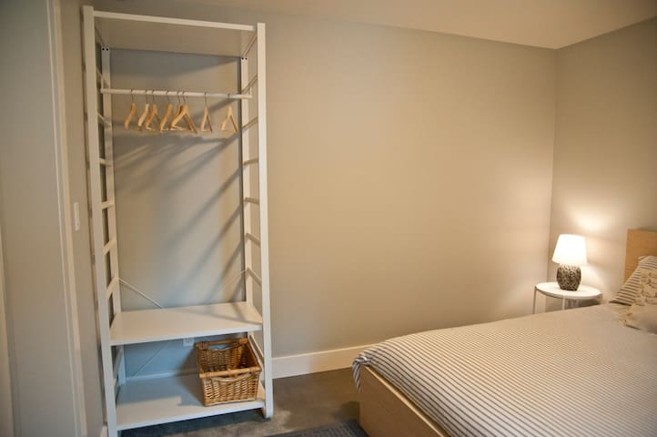 Bedroom hanging and suitcase shelve
