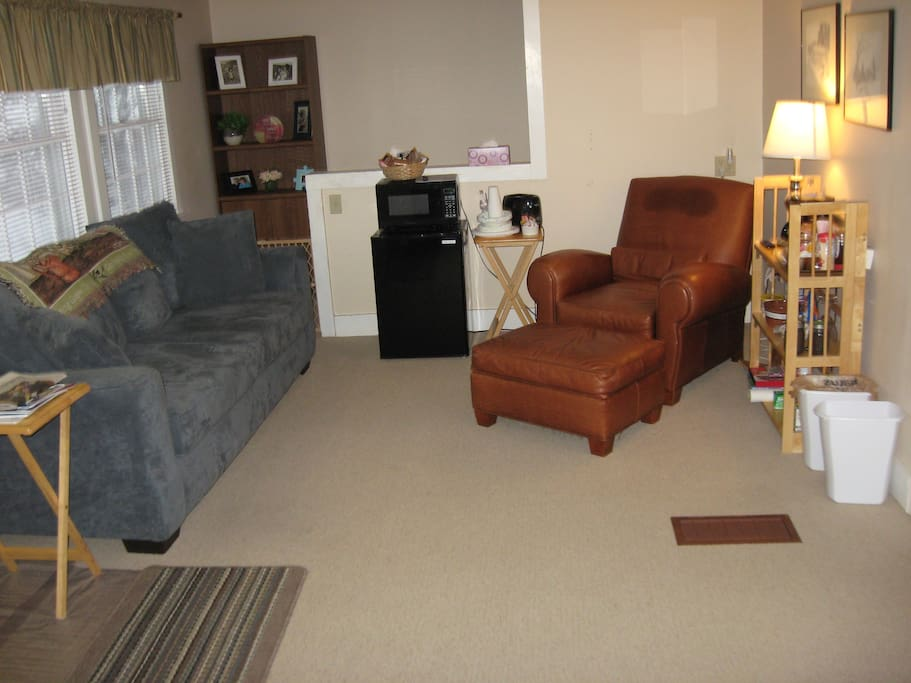 ComfortDen is 12' x 17' with 6' couch and comfortable recliner chair.able sitting/den/TV room.