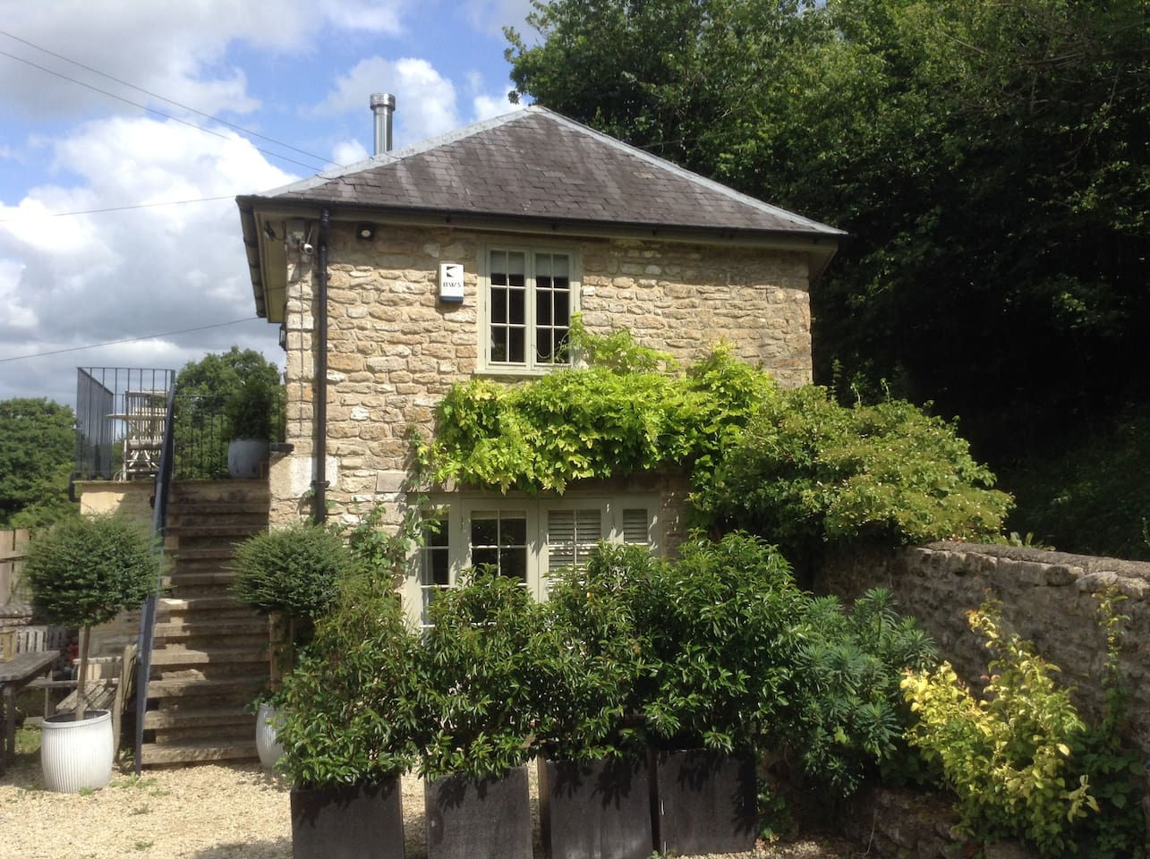The Lodge, St Catherine - wisteria and scented roses clamber up the stonework.
